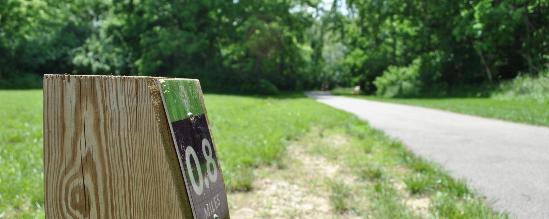 mile marker on park trail