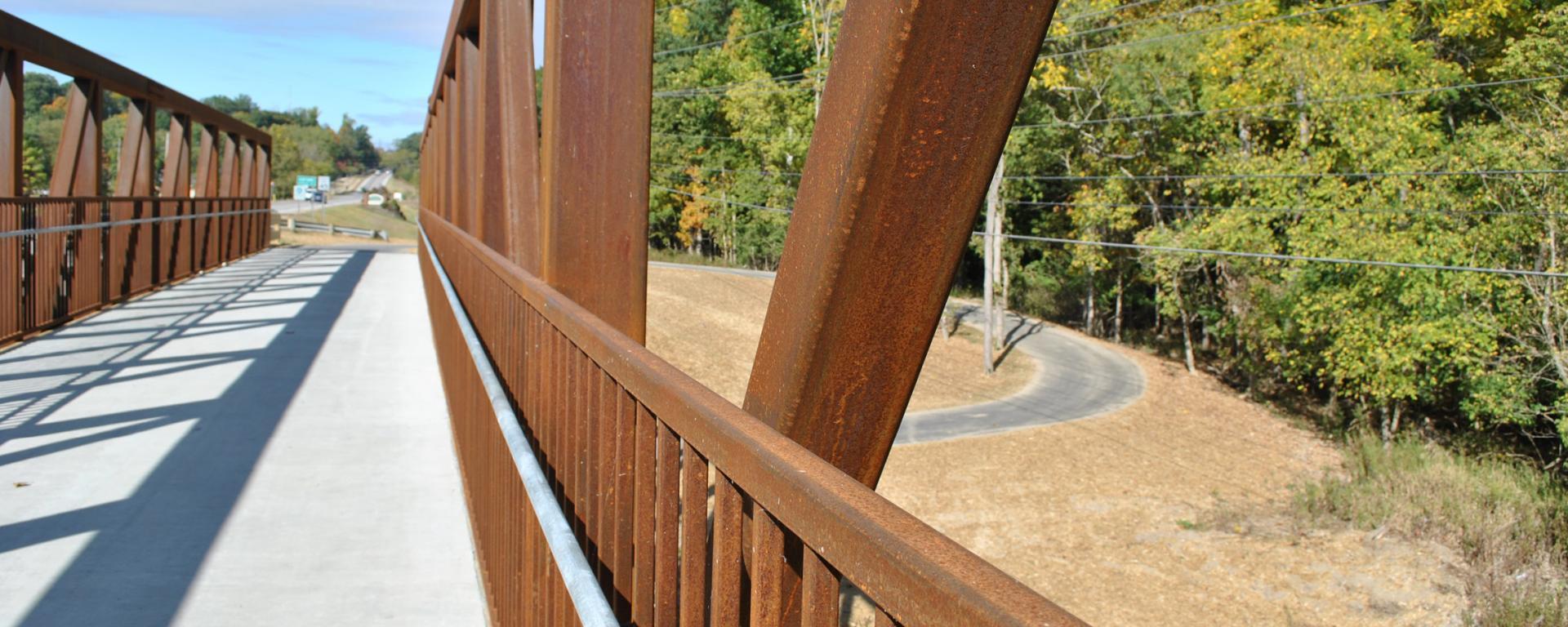 bridge over winding walking trail